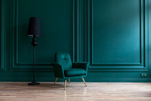 Beautiful Luxury Classic Blue Green Clean Interior Room In Classic Style With Green Soft Armchair. Vintage Antique Blue-green Chair Standing Beside Emerald Wall. Minimalist Home Design.