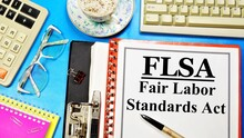 FLSA. The Fair Labor Standards Act. Text Label On The Folder. Guaranteed Right To A Minimum Wage And Overtime Pay.