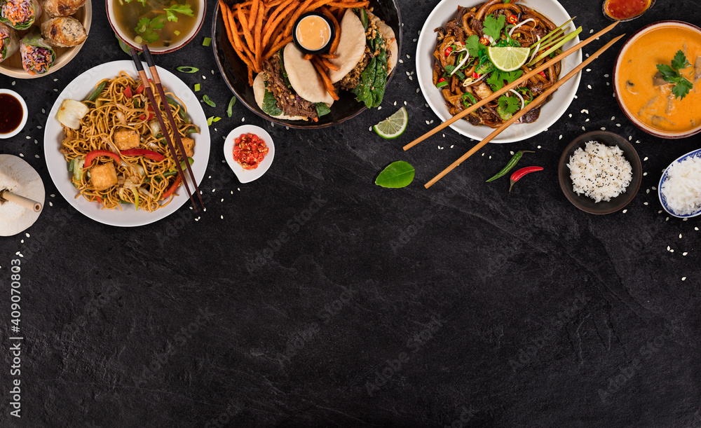 Fototapeta Asian food served on black stone table, top view, space for text. Chinese and vietnamese cuisine set.