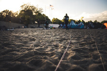 Lines Attached To A Kiteboarding Kite Lay On A Beach In Boston