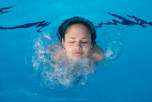 Young Girl Face Popping Out Of Pool