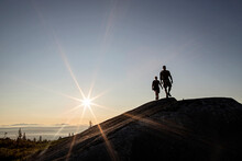Two Hikers Walk Above Tree Line On Moxie Bald Mountain In Maine.