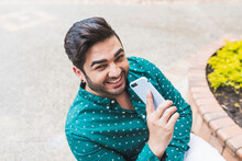 Handsome Man Chatting On His Smartphone
