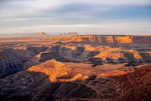 Sunrise Over The San Juan River, Monument Valley In The Distance, Utah
