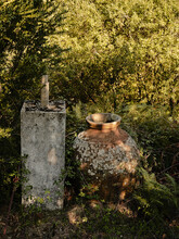 Dappled Light On Large Vase In Portuguese Countryside