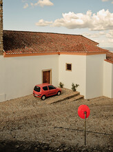 Old Compact Orange Car Parked In Town Of Marvão