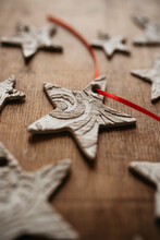 Homemade / DIY Clay Star Ornaments For Christmas Tree On Wooden Surfac