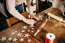 Young Woman Creating Star Ornaments With Clay For Christmas