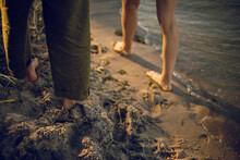Feet On The Beach. Feet On The Sand Near Water. Couple In Love By The River.
