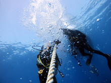 Divers Hold Onto The Boat Rope To Wait For The Surface. Antalya Turkey