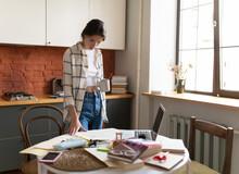 Female Student Taking Break While Preparing For Exam At Home