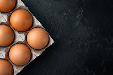 Brown Eggs In Carton Box Tray, On Black Background, Top View Flat Lay , With Space For Text  Copyspace