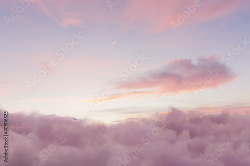Fototapeta view to soft purple sky with fluffy clouds and crescent moon obraz