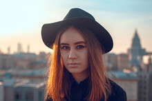 Girl With Hat On The Roof