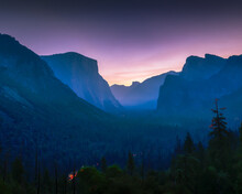 Pink Sunrise At Tunnel View At Yosemite. Car Lights In Valley.