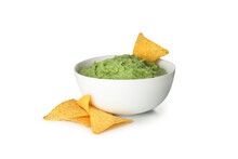 Bowl Of Guacamole And Chips Isolated On White Background