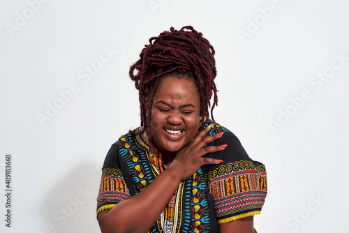 Fotografie, Obraz Portrait of plump young haitian woman laughing out loud