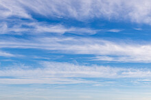 High White Cirrus Clouds With Cirro-stratus In A Light Blue Sky, Sometimes Called Chair Tails, Indicate Nice Weather, But Stormy Changes Come Within A Few Days. White Clouds In A Blue Sky.