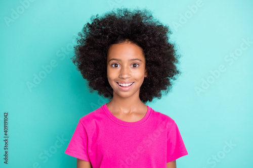 Obraz Photo portrait of excited afro american girl isolated on vivid cyan colored background - fototapety do salonu