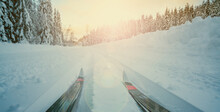 Panoramic View Of  Cross-country Skiing Tracks With Ski's In A Beautiful Winter Wonderland With Scenic Evening Sunset Light.
