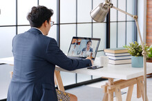 Young Asian Funny Businessman Wearing Underwear Boxer Work At Home And Virtual Video Conference Meeting With Colleagues Business People, Online Working, Video Call At Home Office