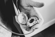 Checking The Time In A Suit On A Silver Gold Pocket Watch Open And In Hand Late Early Ticking Clock Ahead Of Schedule In Black And White