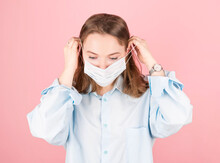 A Woman Wears An Antivirus Mask To Prevent Others From Contracting The Coronavirus COVID-19 And SARS Cov 2
