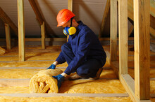 Man Installing Thermal Roof Insulation