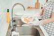 Leinwandbild Motiv Washing dishes. Washing the plate.