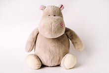 Plush Stuffed Toy Hippo Sits On A White Background