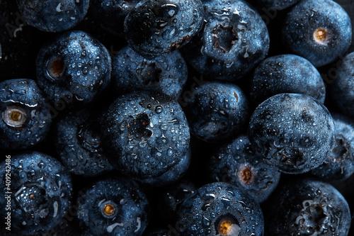 Foto Fresh natural antioxidant blueberries pile, macro detailed close up
