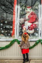 Toddler Reaches For Santa Through Window