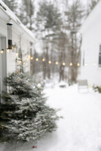 Dreamy Image Of Patio In The Snow With Lights And Christmas Tree