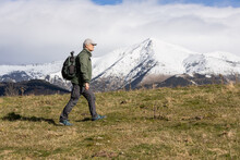 Middle Aged Caucasian Tourist Man Walking On The Spanish Pyrenees