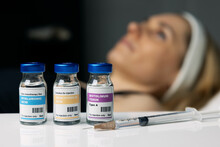 Woman Receiving Cosmetic Anti Aging Procedures At Beauty Salon. Aesthetic Treatment. Injection Vials