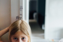 Measuring Girl's Height At Home On Door Frame