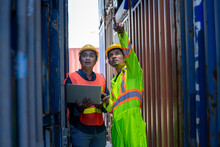 Two Foreman Workers Discussing And Checking In Shipping Yard At