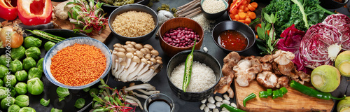 Fototapeta Asian raw vegan food, grain, seeds and vegetables on dark background obraz