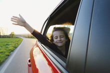 The Girl In The Car Stuck Her Hand Out Into The Wind. Travel.