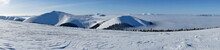 Panoramic Incredible Breathtaking View Of Winter Snow-capped Mountain