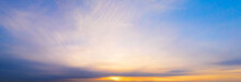 Panoramic Purple Sky With Yellow Winter Sun And Stratocumulus Clouds. A Panorama Of The Cold Blue Sunset Sky.