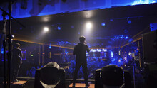 A Singer With Music Band Performing On A Stage Concert With Lighting Laser Beam Spotlight Show In Disco Pub Club Bar For Party Music Dancing Festival Performance. Entertainment Nightlife. People.