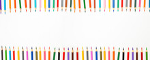 Banner From Frame Color Pencils In A Row With The Top On A White Background.