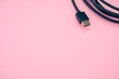 Closeup shot of HDMI cable isolated on a pink background