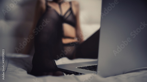 Internet web cam model beautiful woman working online with laptop. Concept virtual sex