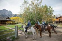 Mature Women Friends Horseback Riding On Idyllic Autumn Ranch