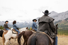 Retired Couple Friends Horseback Riding In Scenic Canadian Rockies