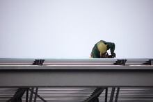 Construction Worker On Roof Building Metal Structure Yellow Hat