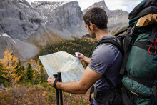 Male Backpacker With Map And Compass In Mountains, Canadian Rockies