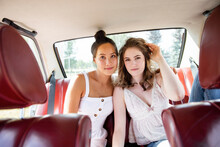 Portrait Confident Beautiful Teenage Girl Friends In Back Seat Of Car